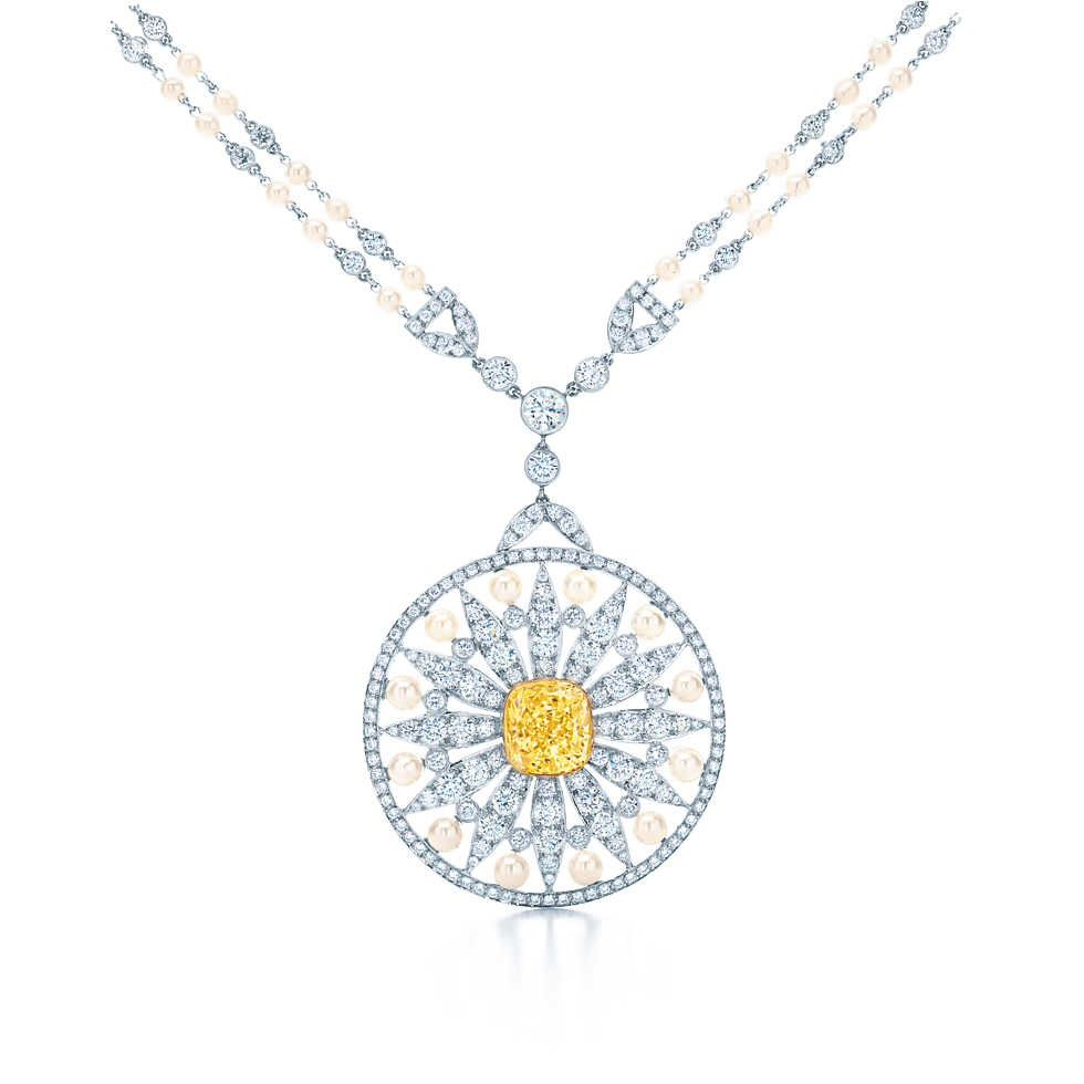 b774cdc35 Pendant with a yellow diamond, white diamonds and Keshi and cultured pearls  in platinum and 18k gold.
