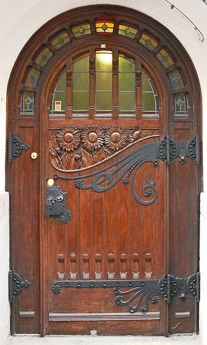 Beautiful carved wooden door with glass and metal.