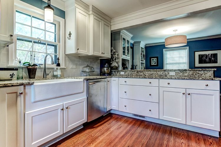 Blue and white kitchen renovation with dark stained