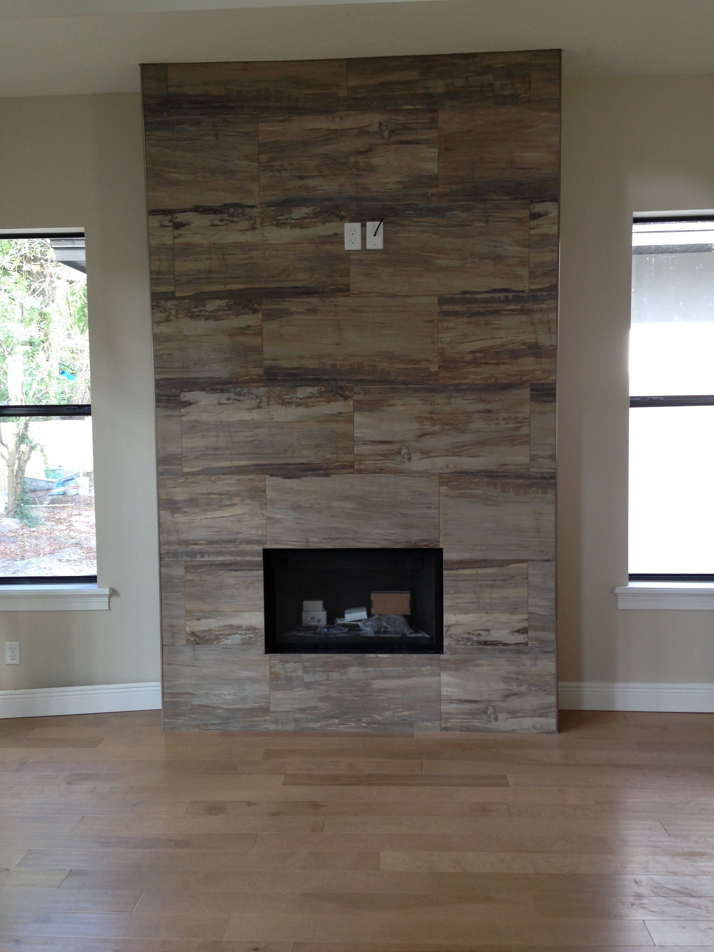 J wood tile makes an absolutely stunning fireplace for Wood fireplace surround designs