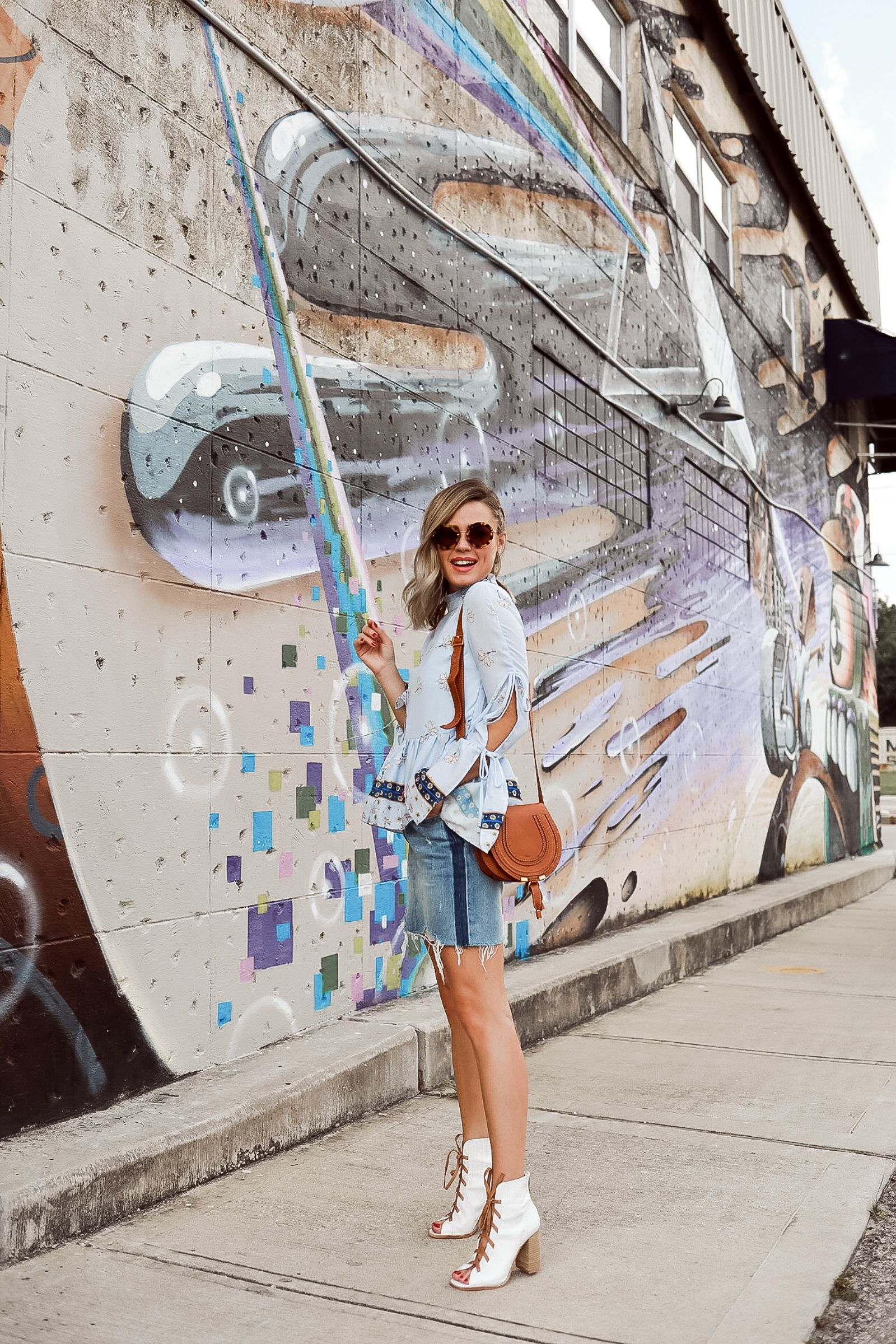 a3f86f750e63 Houston fashion blogger Uptown with Elly Brown wears a denim skirt for Fall