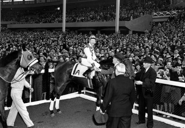 "Johnny ""Red"" Pollard in the winner's circle after his horse Seabiscuit won the $100,000 Santa Anita Handicap at Santa Anita Park in Arcadia,..."