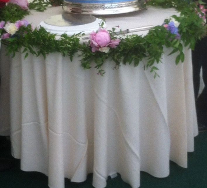 Cake table fresh flower garland with jasmine, roses and peonies.