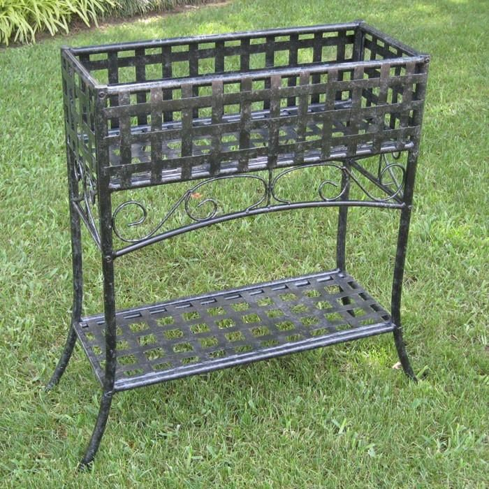 This Elevated Rectangular Metal Planter Stand In Black Wrought Iron