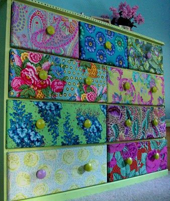 fabric on dresser drawers for storage or crazy quilt look with scrapping paper.
