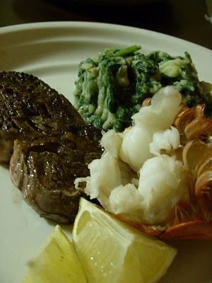 Filet mignon, lobster and garlic mashed potatoes and wilted spinach.