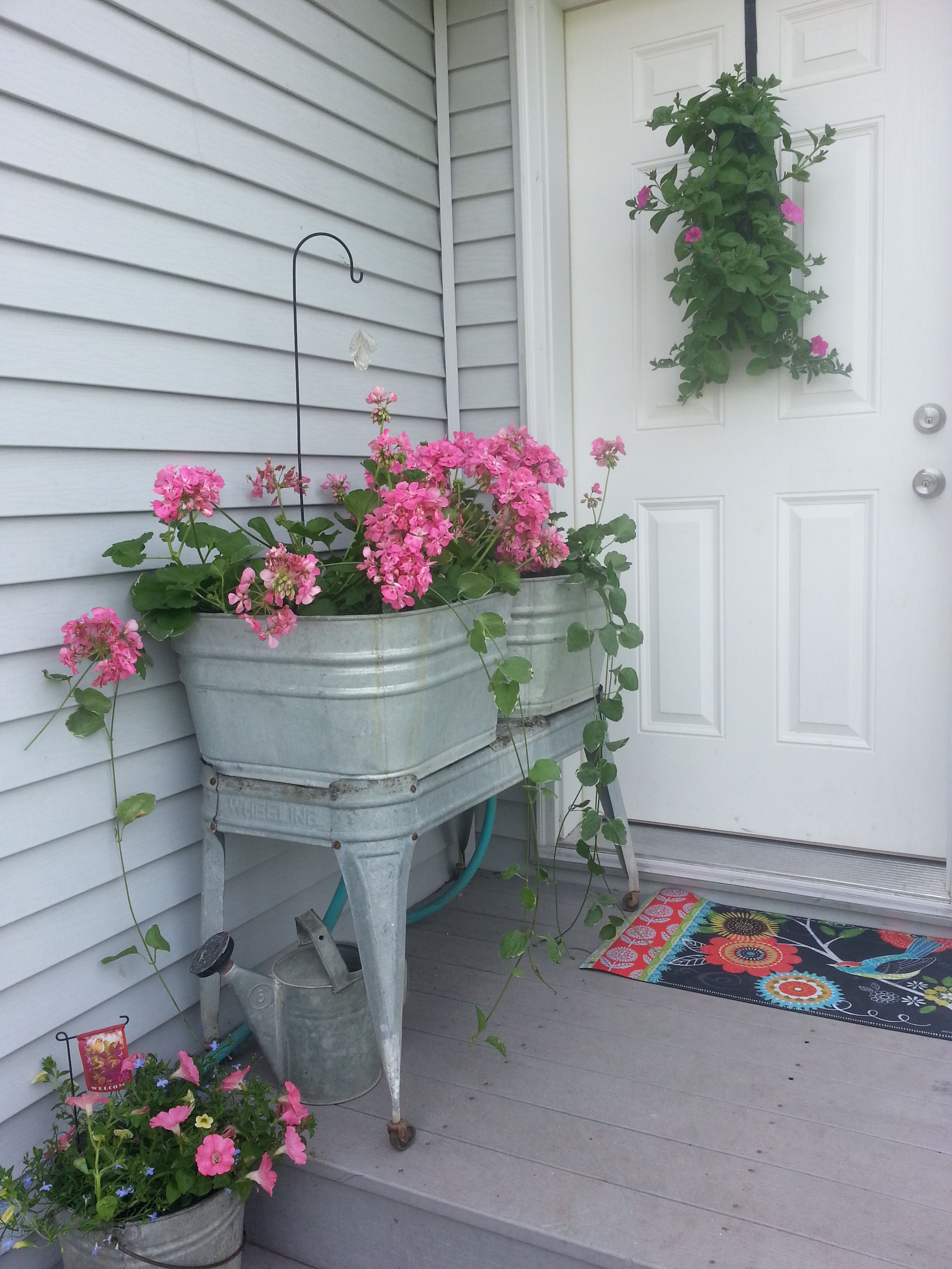 My Front Porch Decorated With Vintage Wash Tubs And Galvanized Buckets Of Flowers Summer Porch Decor Front Porch Decorating Container Garden Design
