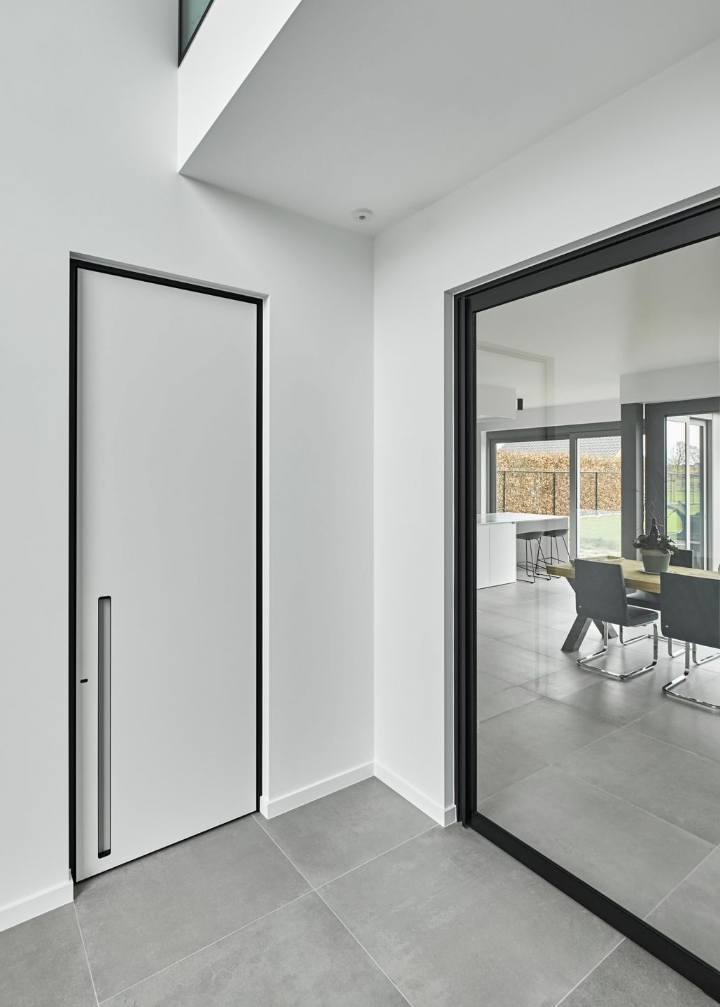 Modern White Interior Door With A Black Door Frame And A Built In