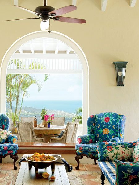 Vibrant Patterns And Large Arched Windows Make This Living Room A Best Wing Chairs For Living Room Review