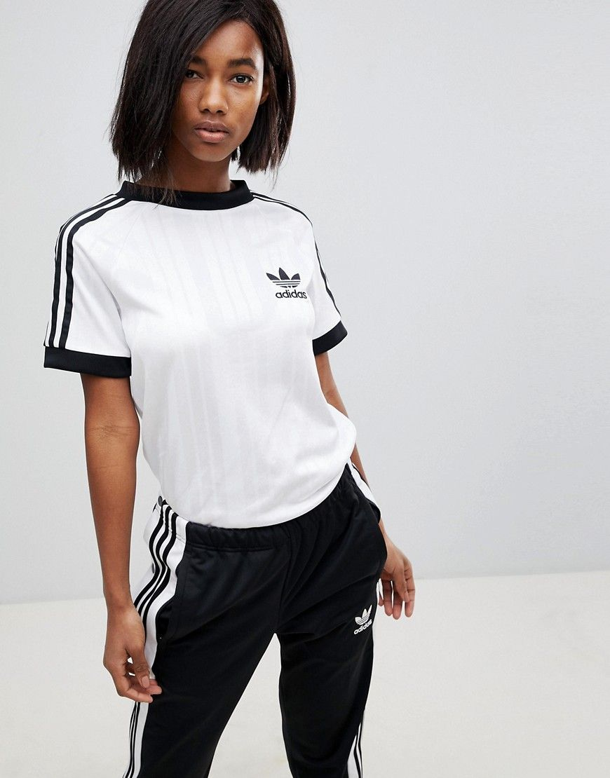 e58d94a38a9 ADIDAS ORIGINALS ADIDAS ORIGINALS THREE STRIPE POLYKNIT T-SHIRT IN WHITE -  WHITE. #adidasoriginals #cloth #