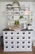 I love all the little drawers.  Makes for a great Buffet for a dinner party.