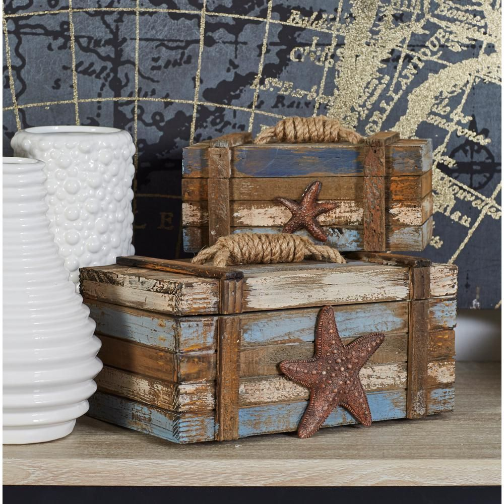 Litton Lane Coastal Rectangular Wooden Plank Boxes (Set of 2) is part of Neutral Coastal decor - This set of 2 decorative boxes features a coastallivinginspires design with its brown starfish adornments  The boxes are made with plankstyle fir wood bodies in a wornout blue, orange and white finish that gives it an appealing rustic look  The lids of the boxes open to reveal spacious rectangular interiors, giving you additional storage options for your room