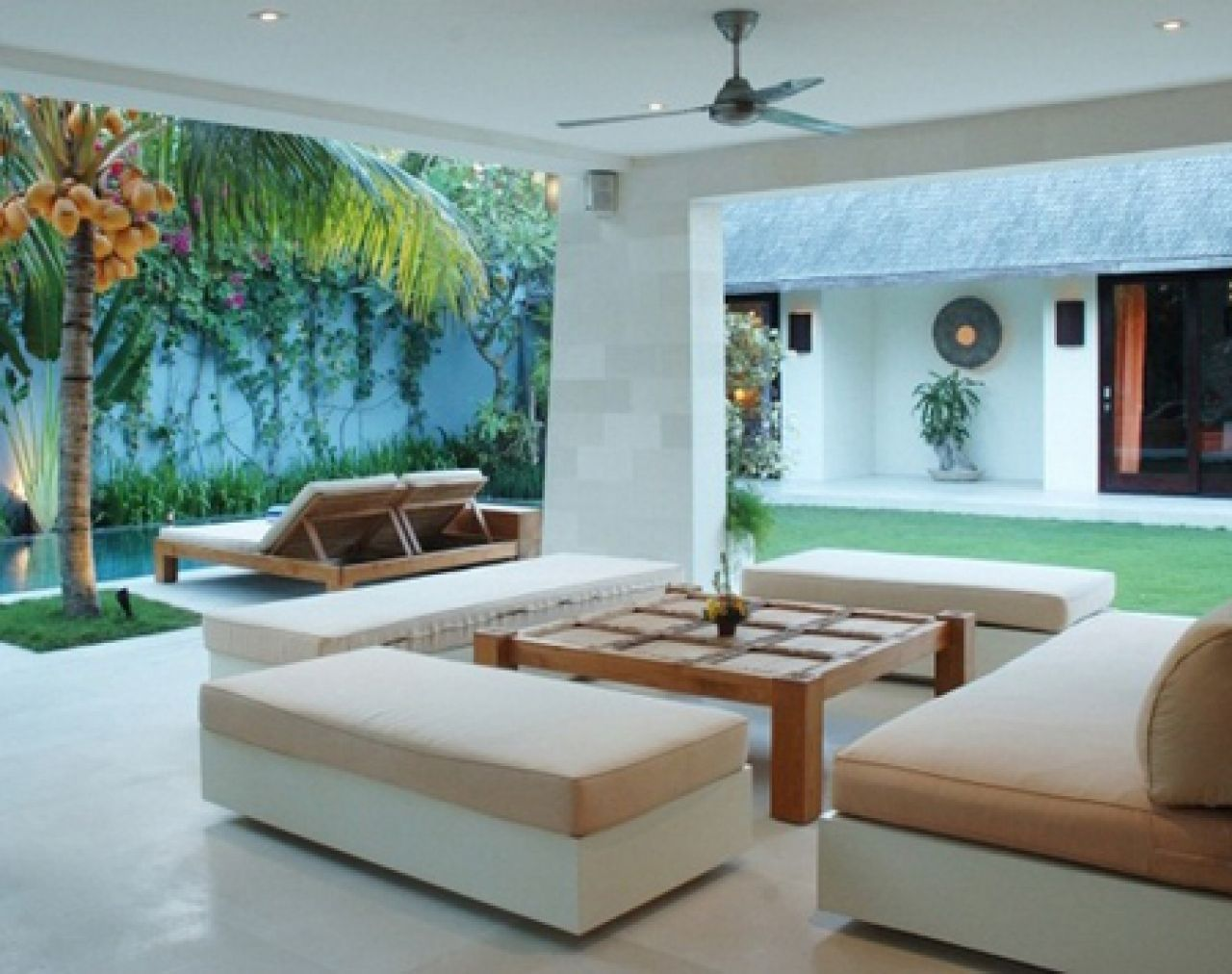 Wonderful Tropical Interior House With Lounge Sofa White And Beige Color Also Wooden  Table And Grass And