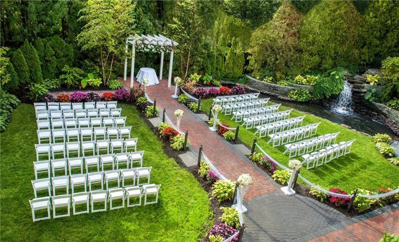 Green Outdoor Garden Wedding Ceremony With White Chairs The Fox Hollow On Long Island N Outdoor Wedding Venues Long Island Wedding Garden Weddings Ceremony