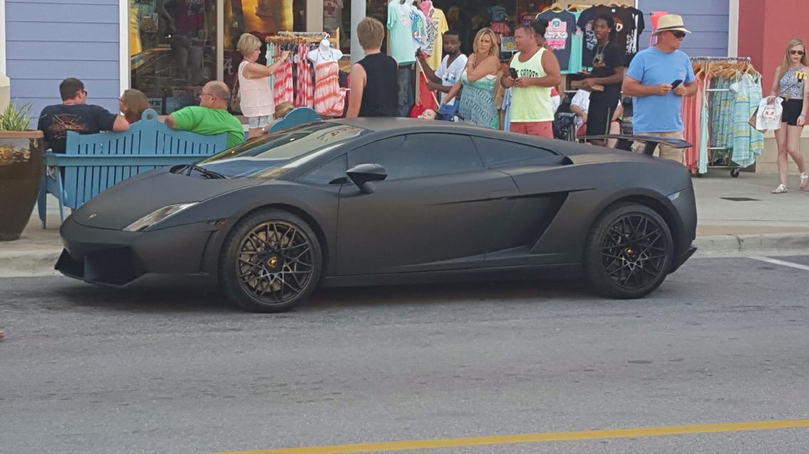 Flat black sports car sports car flat paint car painting
