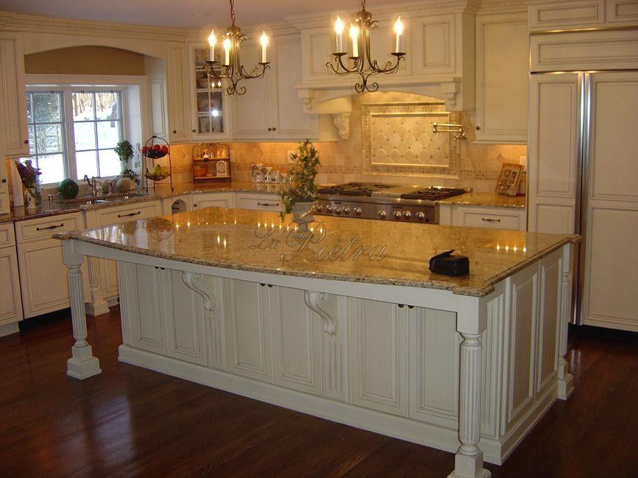 Granite New Venetian Gold Kitchen Countertop With Travertine Tile In