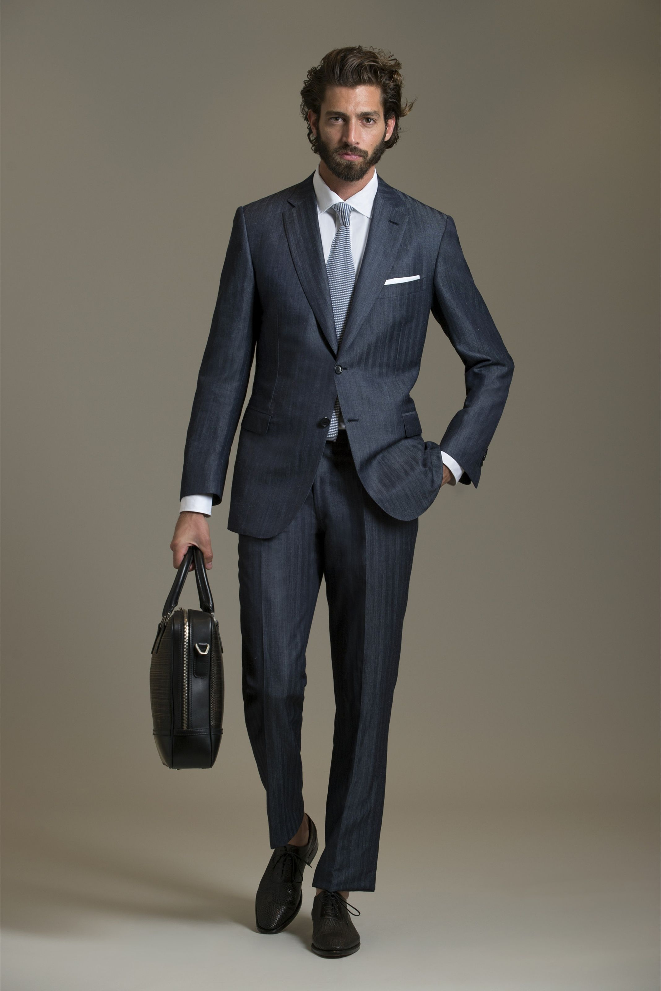 Brioni makes the best suits on Earth.  Yes, they are expensive but if you need a job or a new client buy one.