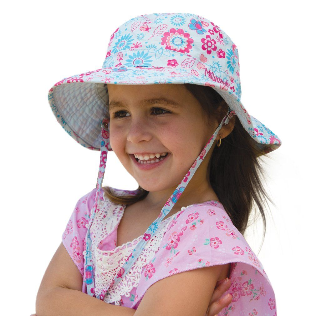 Girls Happy Flower Sun Hat (Large). UPF50+ Sun Protection absolute must for kids. Reversible, two complete hat looks for the price of one. High Quality Materials, Fashionable, Affordable. Adjustable & Removable Chin Strap for secure fit. Travel friendly crushable construction.