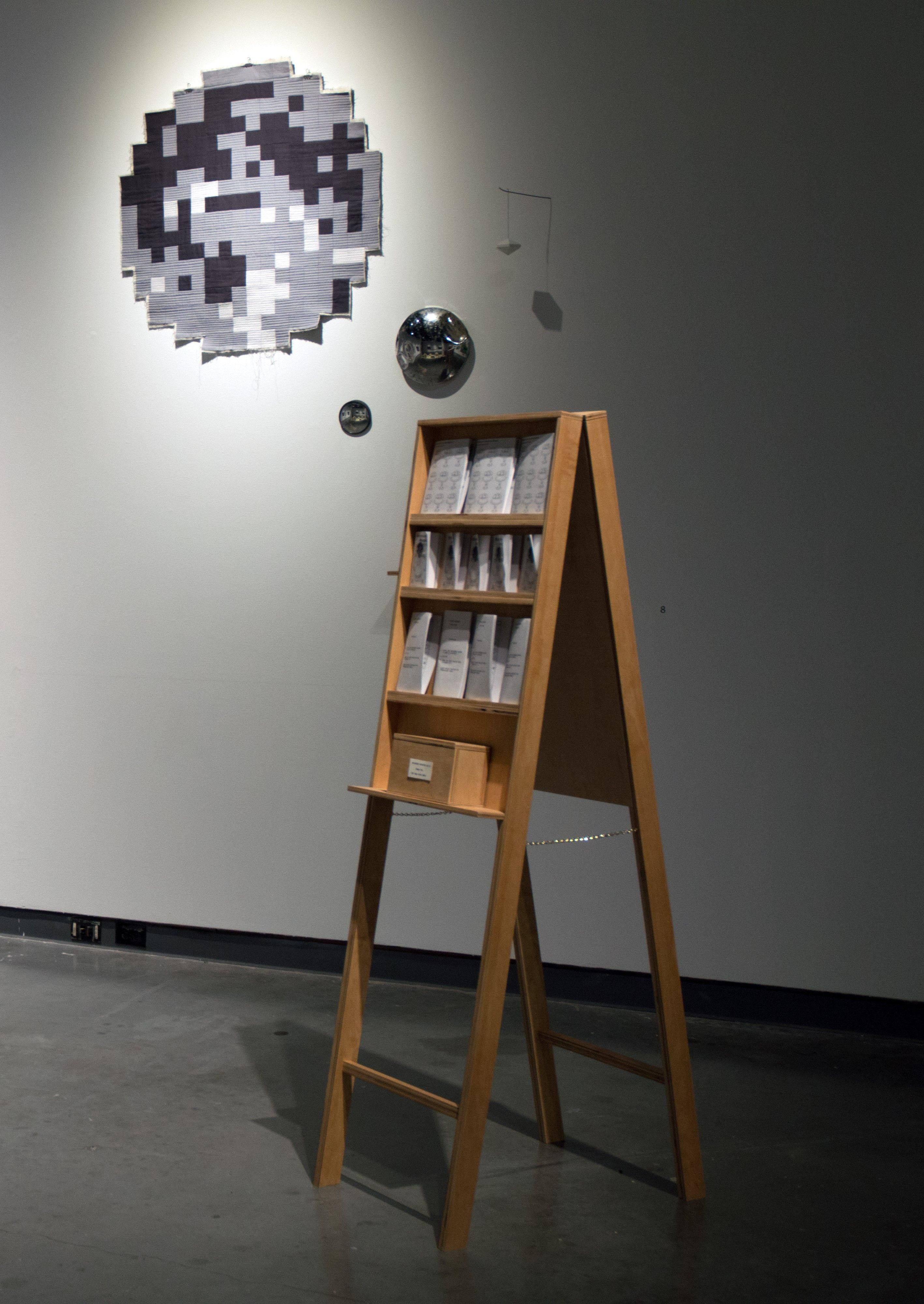 Kate Testa, The Pamphlet Rack and The Moon, 2018, Mixed