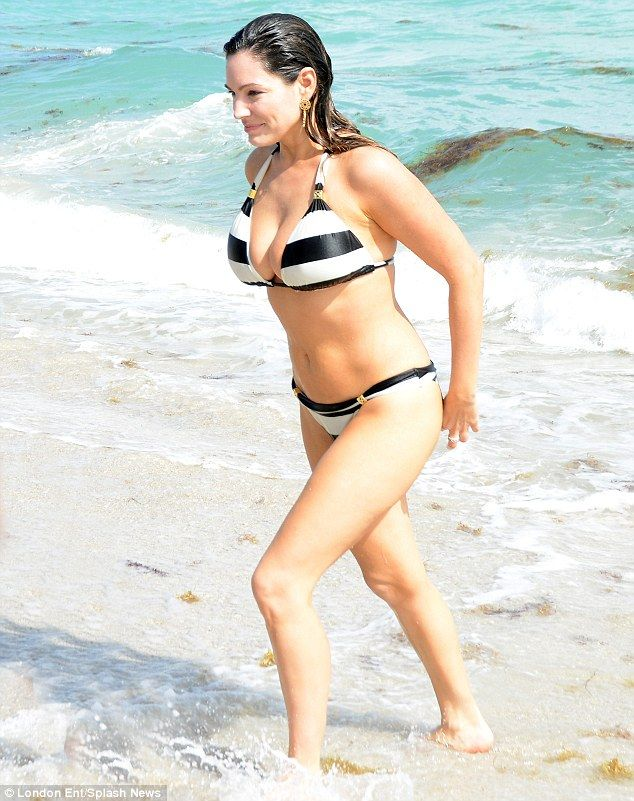 1d0ee403fab91 Kelly Brook frolics in the Florida sea with boyfriend David McIntosh ...