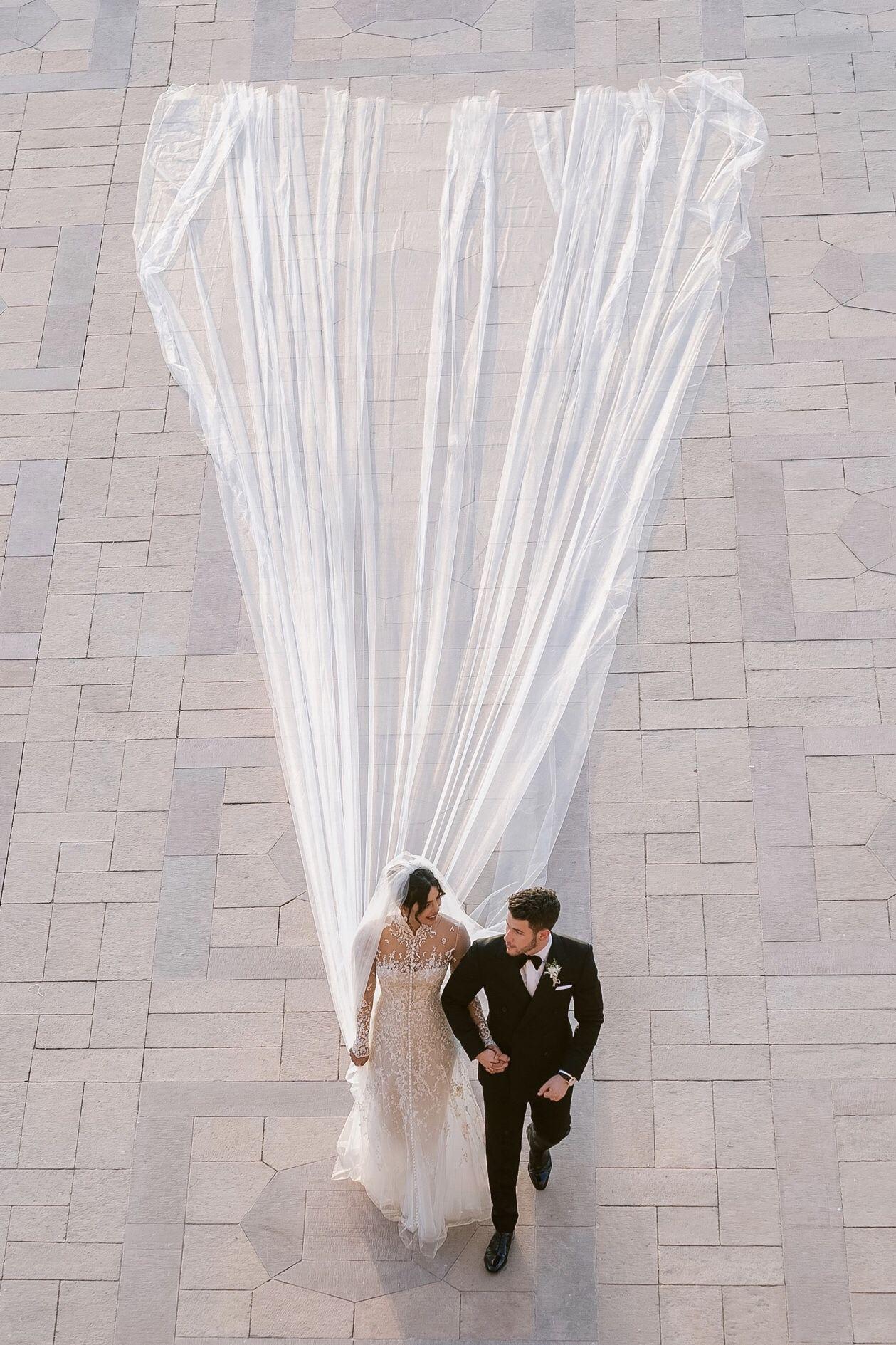 That Priyanka Chopra And Nick Jonas Whose Nuptials Aimed To Fuse Family Traditions Eastern Priyanka Chopra Wedding Romantic Wedding Photos Celebrity Weddings