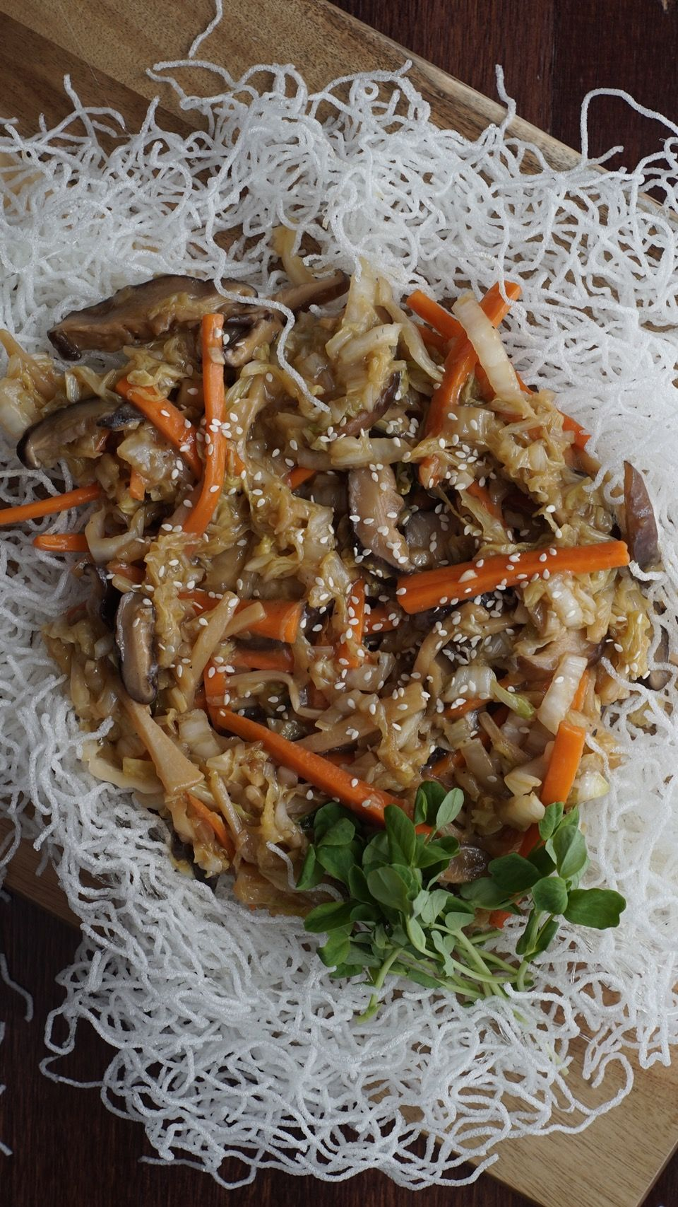 Recipe with video instructions: Witness Julie make puffed vermicelli for the first time. Ingredients: Vermicelli/Glass Noodles, Vegetable oil, 2 cloves garlic, minced, 10 approx. dried shiitake mushrooms, soaked until softened and thinly sliced, 2 medium carrots, julienned , 1/2 cup canned bamboo shoots, julienned , A small napa cabbage, julienned (about 5 cups), ¼ cup soy sauce, 2 tbsp sesame oil, Salt and Pepper, A pinch of sugar, 2 tablespoons cornstarch, dissolved in 2 tablespoo...