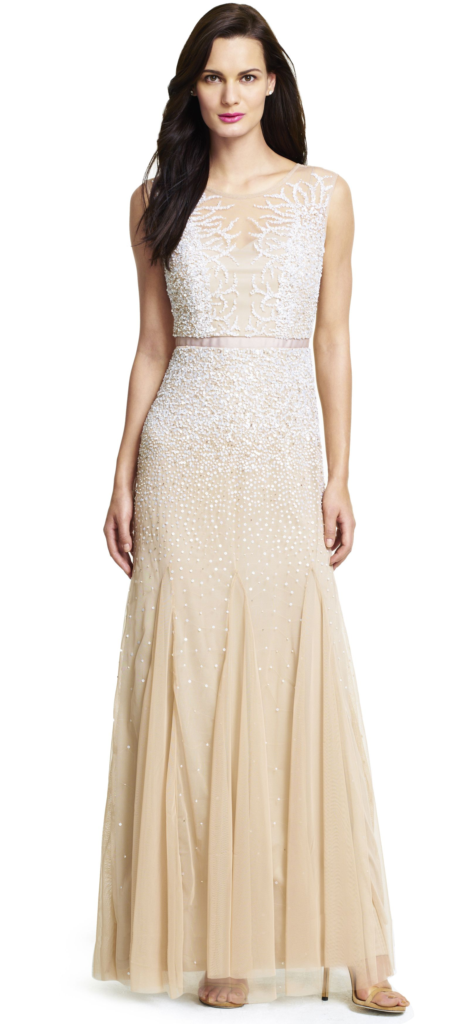 From the sheer neckline to the delicately beaded bodice and V-neck ...