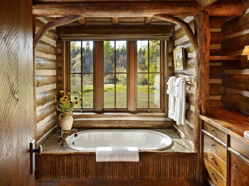 Baie Rustica Intr O Cabana Din Lemn Rotund Log Cabin Kitchens Rustic Bathrooms Built In Bathtub