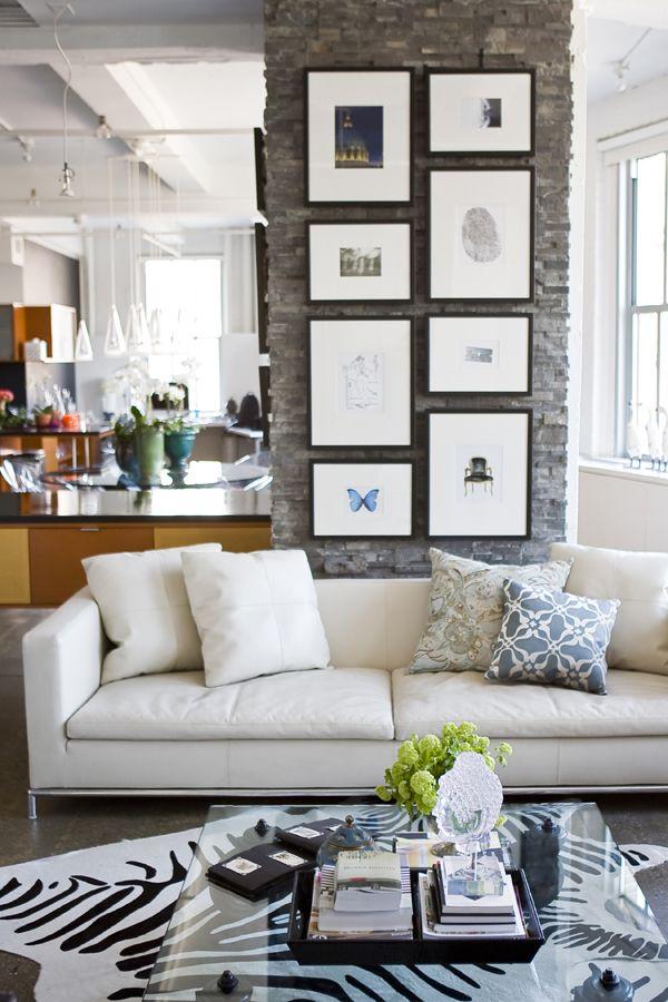 clean beautiful living room zebra rug, wall art, white sofa, open to ...