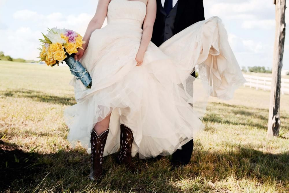 Bride in her cowgirl boots.     http://www.countryoutfitter.com/products/28187-womens-sonora-boot-bitterwater-brown