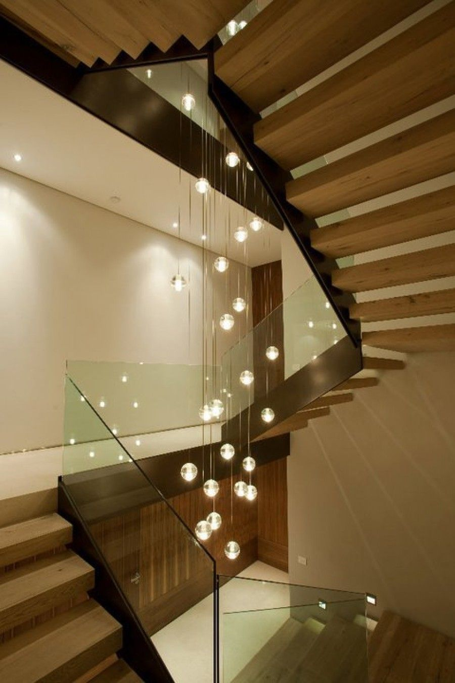 A custom chandelier for the 14 series down through a stairwell.