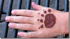 provided brown tempura paint for parents to paint bear claws on their children's faces or hands.