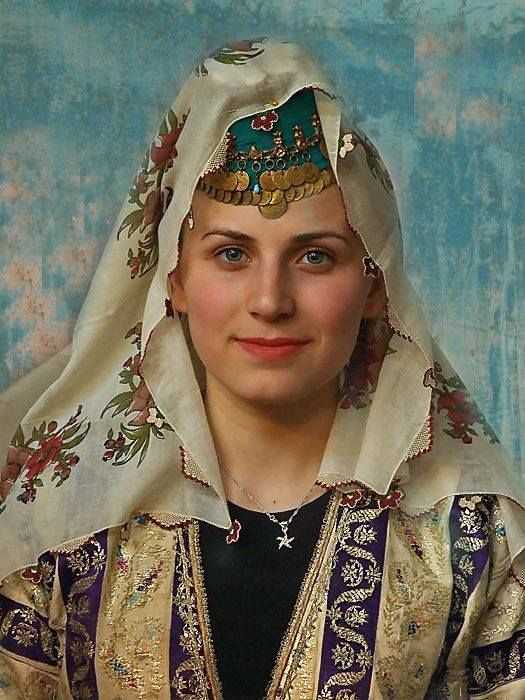 Young Turkish girl in traditional costumes