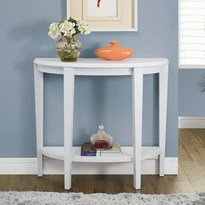 Whether you want a spot to stage a vignette or just want to add a traditional touch to your space, this lovely console table is a must-have for your home. The simple silhouette and neutral finish let this piece blend in with any setting, while the curved, half-moon shape is complimented by the chic tapered legs for a look that is brimming with classic sophistication. This table also features a lower shelf that provides extra storage space. Try setting this piece in your entryway, then top it…