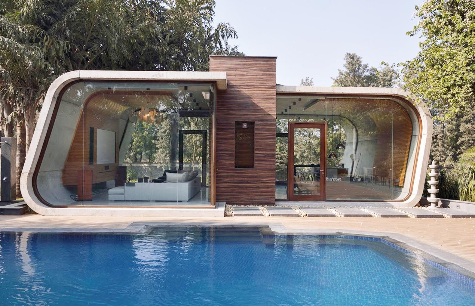 Design House Pools 42mm architectures sculptural pool house in india is wrapped a curved concrete shell