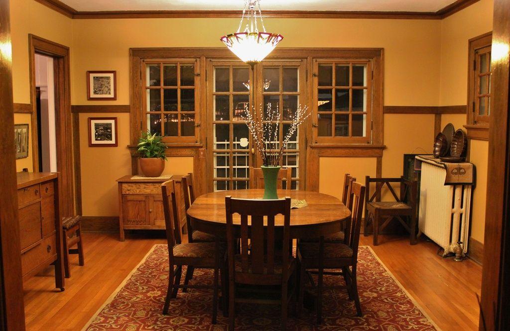 Craftsman Dining Room With Area Rug Hardwood Floors Chair Rail Bowl Pendant Light