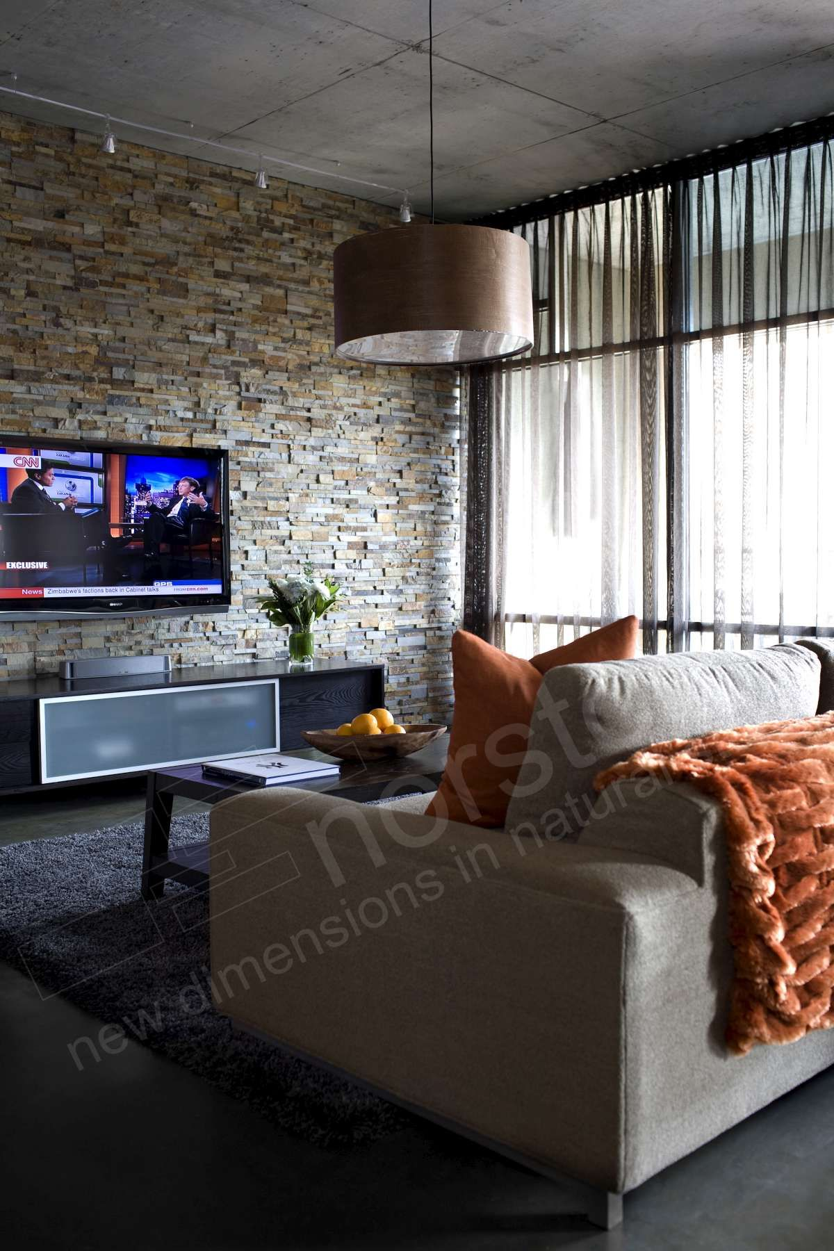 Flat Screen Tv Installed On Stacked Stone Wall Living Room
