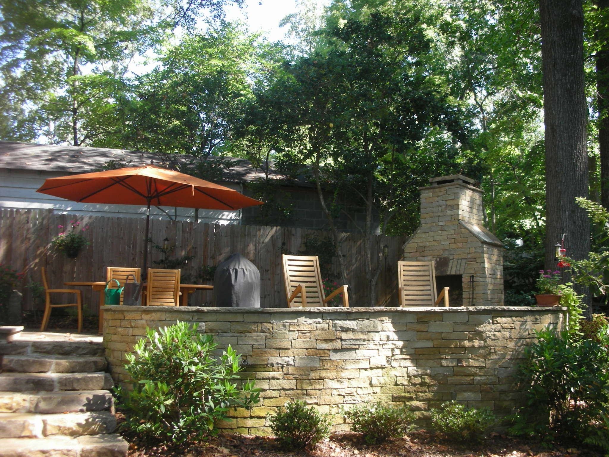 Outdoor Living area with raised flagstone patio, rubble ... on Rock And Stone Outdoor Living id=66603
