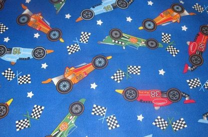 Check out this item in my Etsy shop https://www.etsy.com/listing/103999729/2-yards-of-racecar-fabric