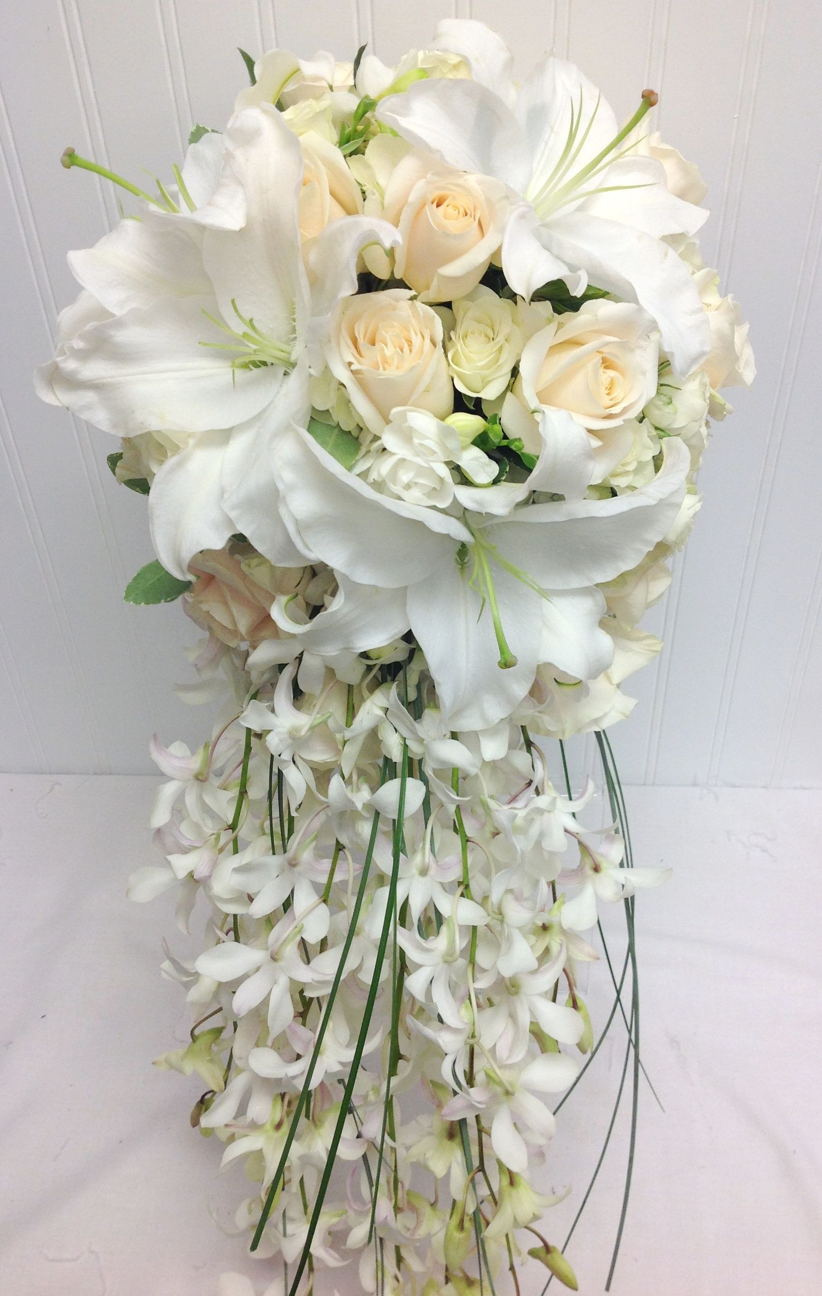 White cascade bridal bouquet with white lilies roses for Flower sprays for weddings