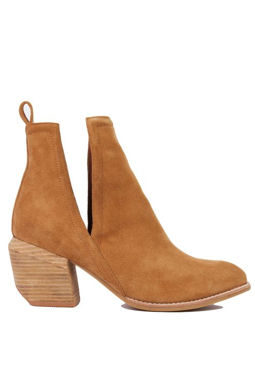 AKIRA's Jeffrey Campbell Orwell 2 Open-Side Ankle Camel Suede Booties, featuring a genuine leather upper, pull tab at back for easy slip-on, deep V side cut outs, angled & stacked wooden heel, and a pointed toe. Free standard U.S. shipping $75+.