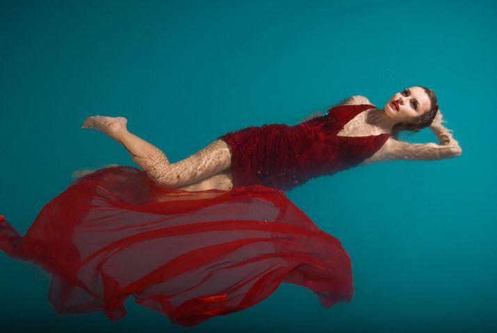 Lady in Red by Shutterstock Contributor Julenochek - 82633426