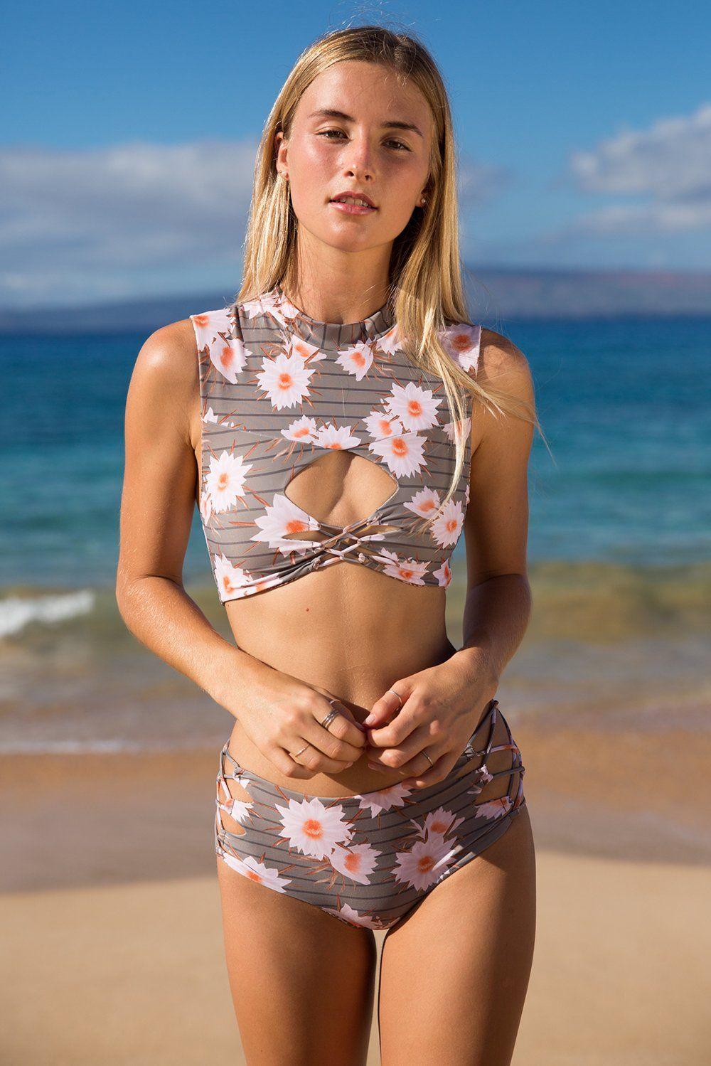 7e674c0919b019 FINAL SALE. The ACACIA Swimwear Amalfi Top features a cropped bikini top  with cutout and criss cross detailing