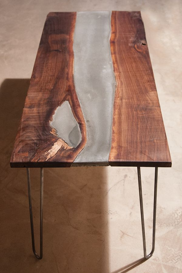 """This is a Coffee table I designed and built. I utilized a live edge walnut slab and countertop quality concrete. The legs are custom fabricated hairpin legs, made with .5"""" steel rods."""