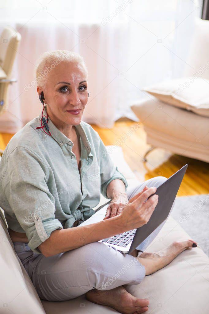 Smiling Relaxing Caucasian Senior Woman Posing With Laptop  Stock Photo
