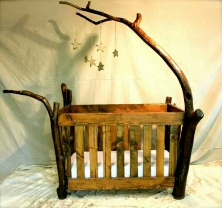 Beautiful rustic crib.  I want Charles to build this when we have a baby.