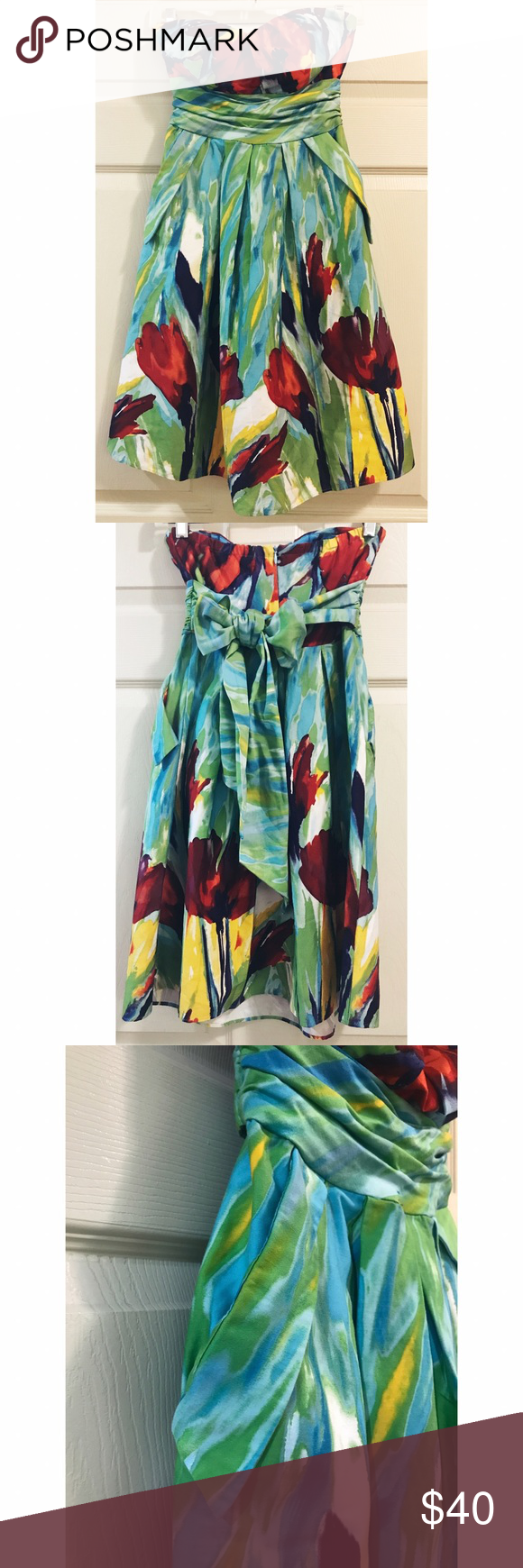 Sophia Christina • NWOT Dress Sophia Christina • NWOT Dress. Beautiful sweetheart neckline and bow back. Zips up in the back. Size 4. Cute flower design. Pockets, which are my favourite in dresses!   . . . . . Suggested Used! 💁🏼 Non-Smoking Household! 🌿 A passionate Posher! 👗 Make an Offer! 🛍 Sophia Christina Dresses Strapless