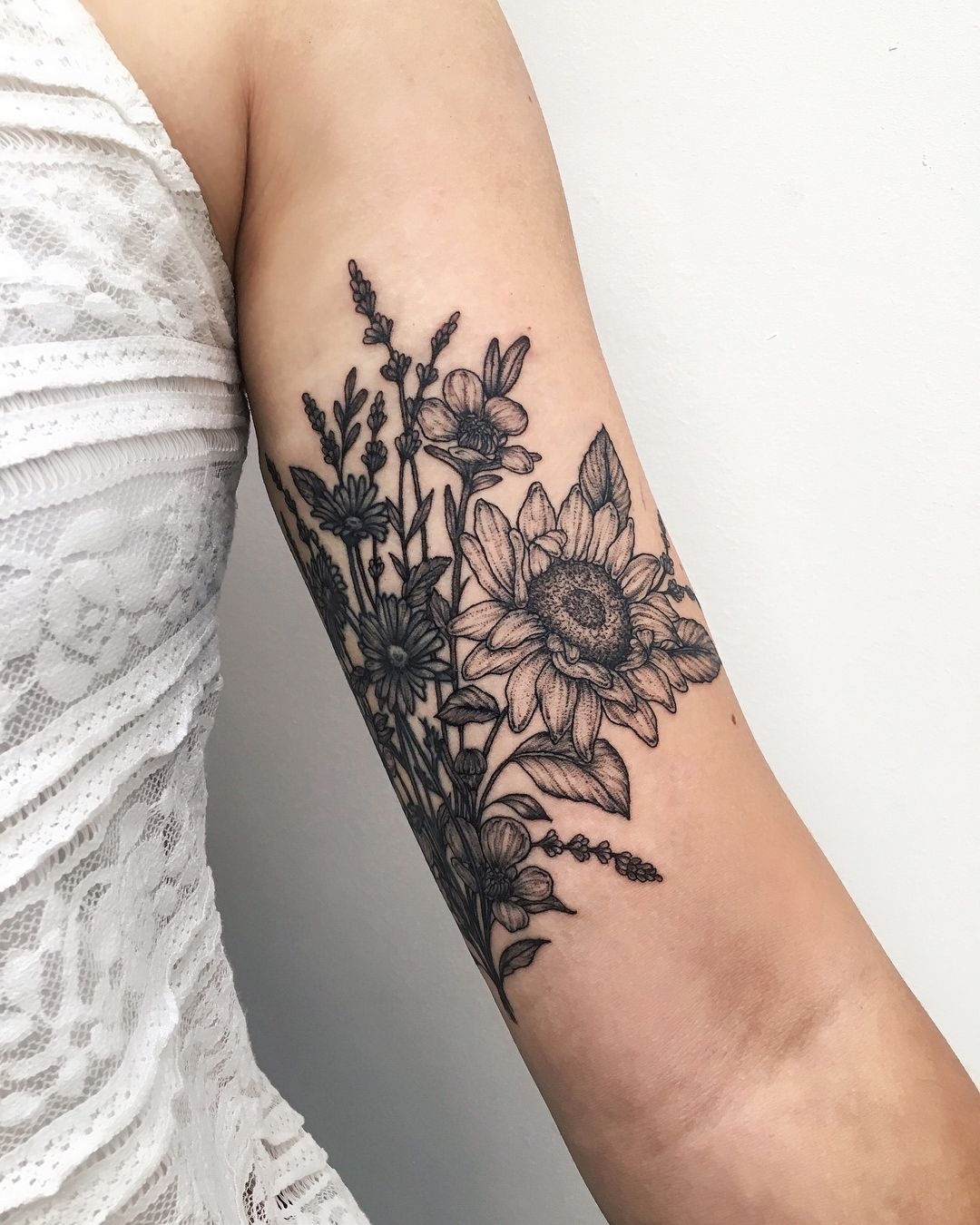 "Yaana Gyach on Instagram: ""have added some manuka flowers🌸, sunflowers🌻 and lavender 🍃 to existing tattoo of daisies (🌼done not by me) ••••• #ygtattooing #gyachyaana…"""
