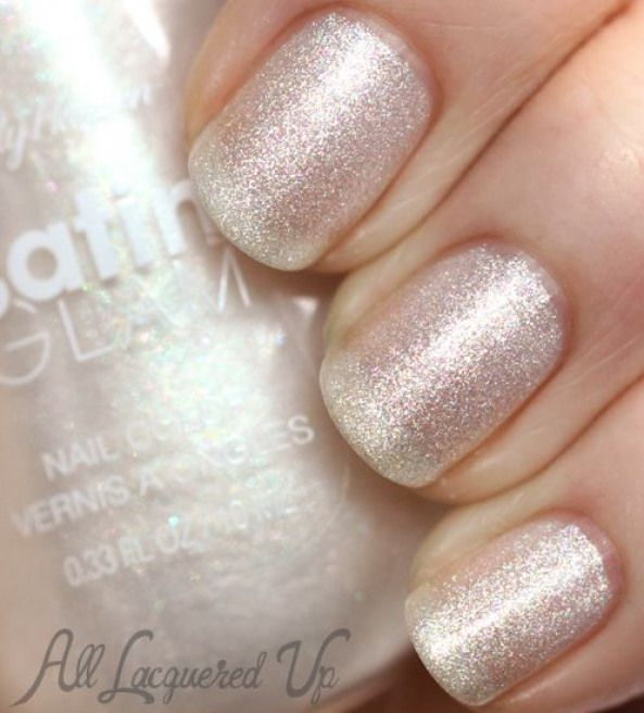 Sally Hansen Satin Glam Crystalline is and icy white filled with pink blue purple and gold flecks
