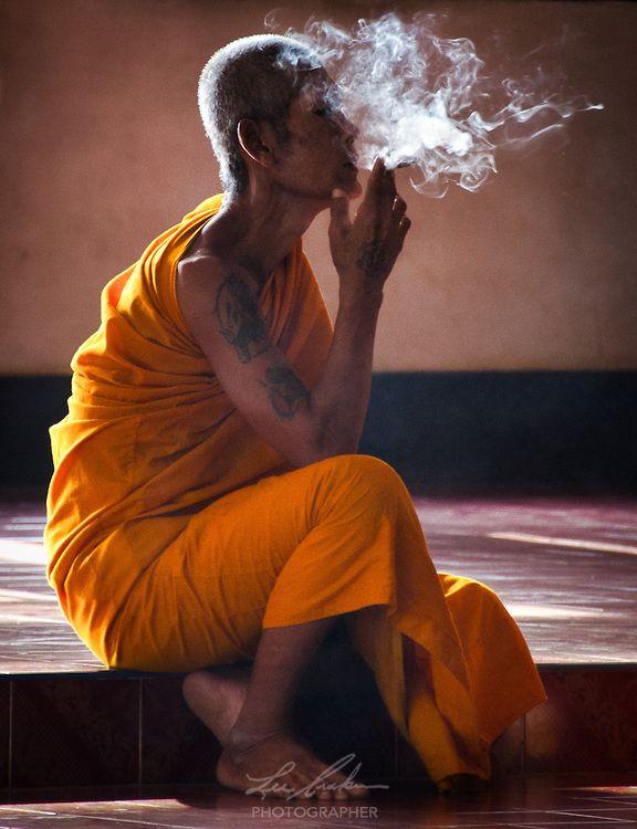 A Monk Takes a Smoke Break in Nakhon Nayok, Thailand